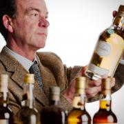 Martin Green of Bonham's inspects a bottle for auction